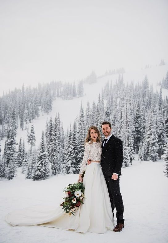 a modern two piece wedding dress with a lace crop top, a plain full skirt with a train for a boho winter wedding