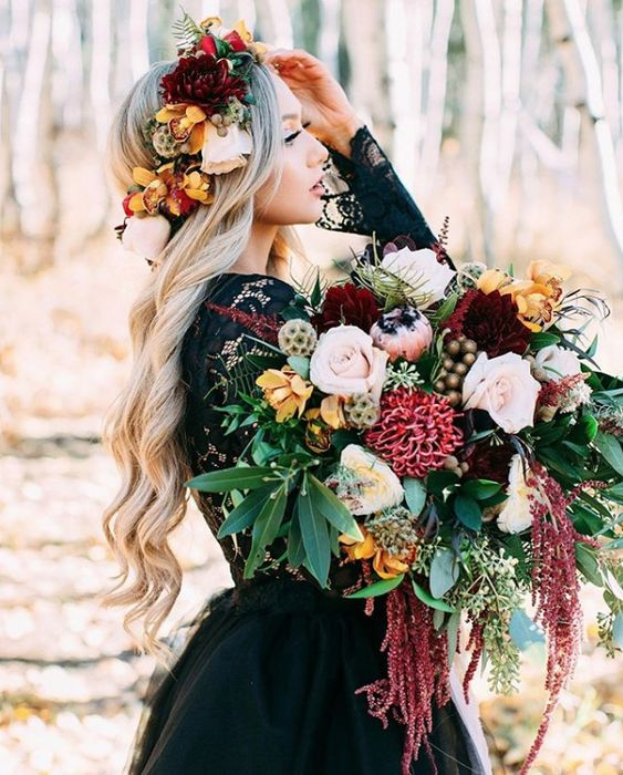a statement fall wedding bouquet of pink, blush, yellow, burgundy blooms, greenery, seed pods and berries plus cascading blooms is amazing