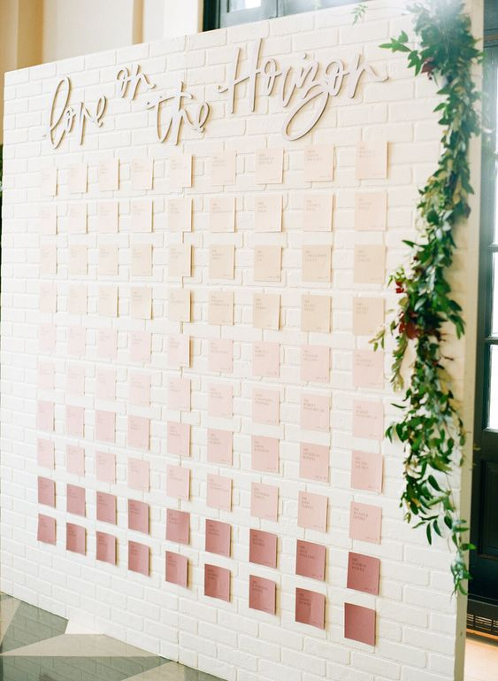 a stylish ombre seating chart from blush to deep pink tones is a lovely idea for many weddings