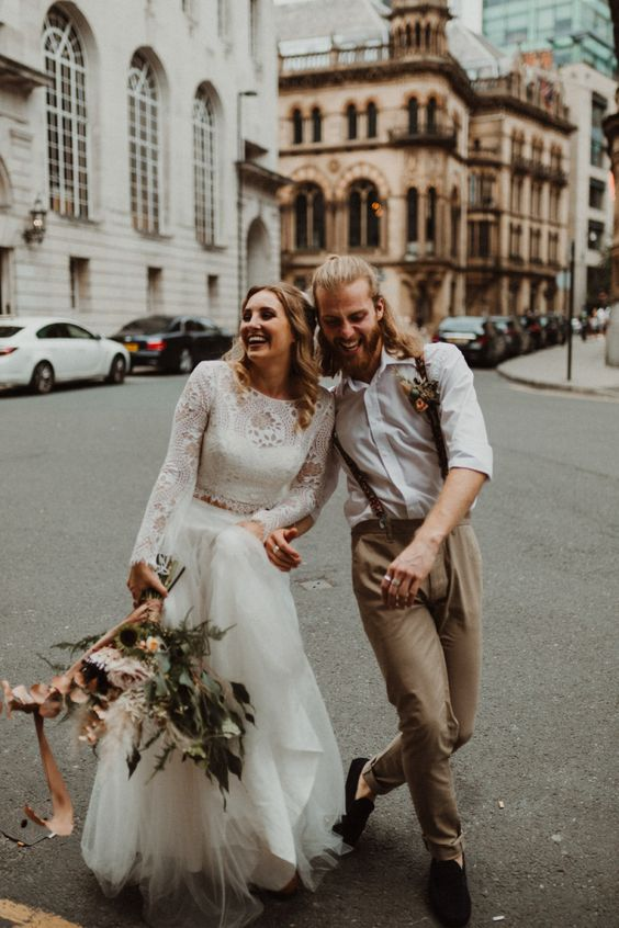 a two piece elopement wedding dress with a boho lace crop top with long shoulders, a tulle layered skirt for a boho feel