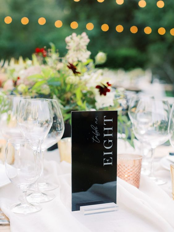 a very modern black and white table number will fit any floral arrangement or a greenery one