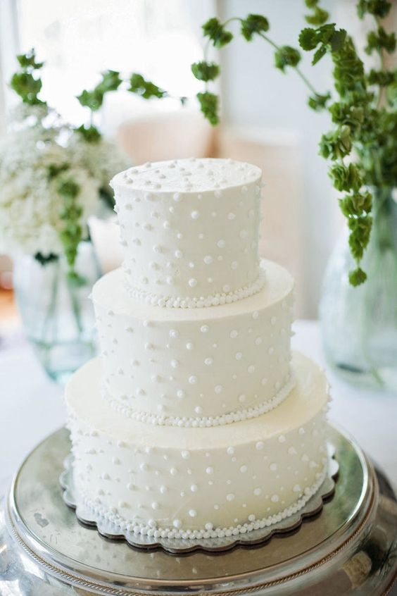 a white pearl and bead wedding cake is a cute and sweet dessert for a modern glam wedding