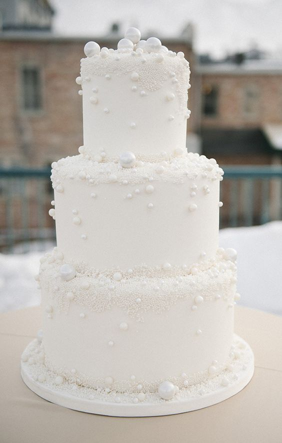 a white pearl wedding cake with mini beads is a gorgeous idea for a modern glam wedding
