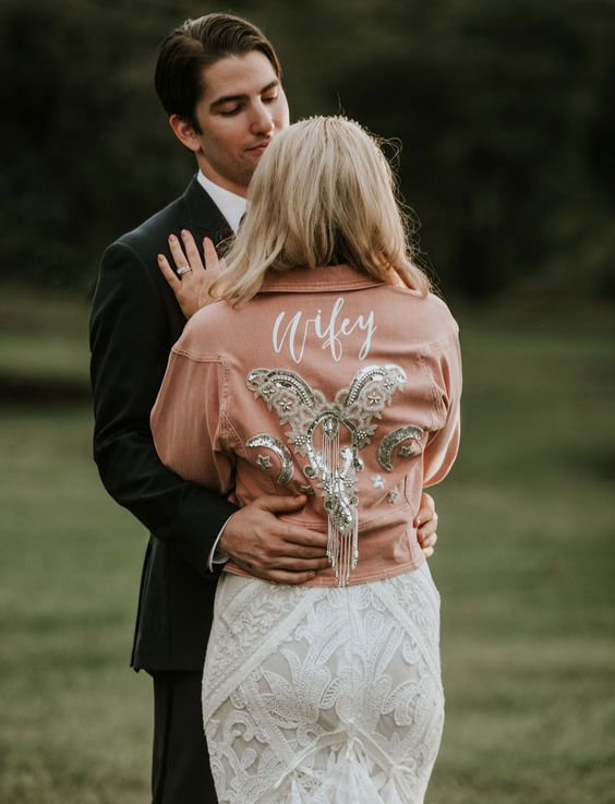 an amber embellished and embroidered bridal jacket with long sleeves is a bold accessory