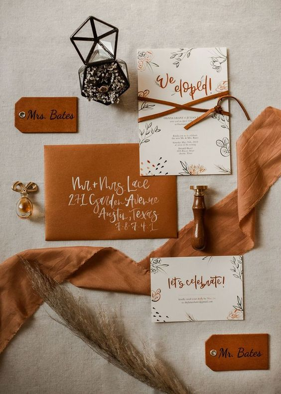 an amber wedding invitation suite with suede and leather and stylish printing is bright and cool
