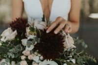 an elegant moody fall wedding bouquet of white, blush, burgundy blooms, greenery is a stylish idea to rock in the fall