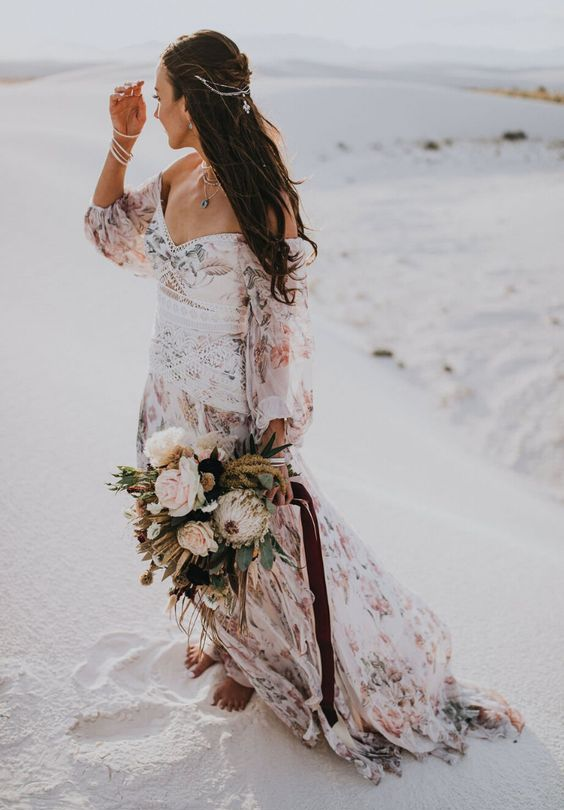 an off the shoulder floral wedding dress with puff sleeves is amazing for a boho elopement anywhere