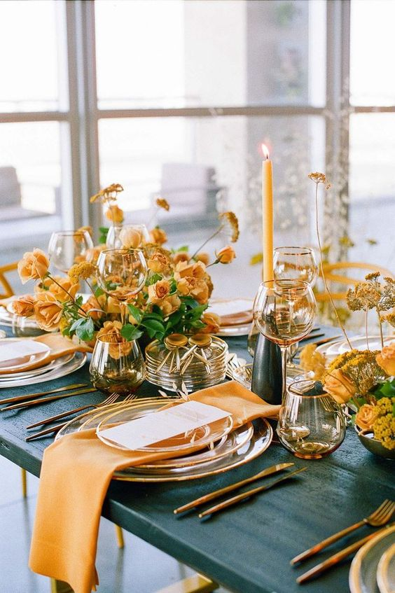 bright fall wedding centerpieces of buttermilk blooms and greenery with some dried elements, matching candles and napkins