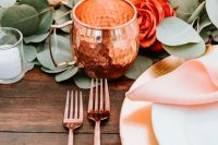 copper mugs, cutlery and a placemat will make your tablescape ultimately chic and cool