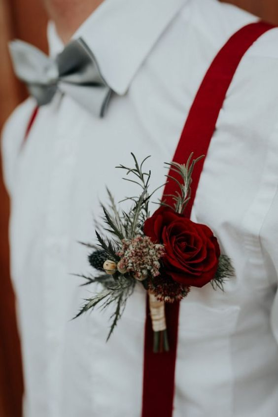 deep red suspenders and a deep red boutonniere will accent a fall groom's look easily