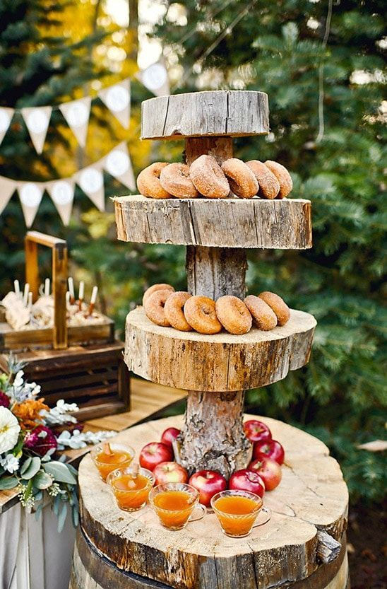 display fall themed desserts and drinks on wooden slices and tree stump stands to embrace your space