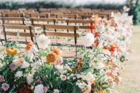 lush blush, creamy, rust florals and greenery to line the wedding aisle will brign a fall feel to the space
