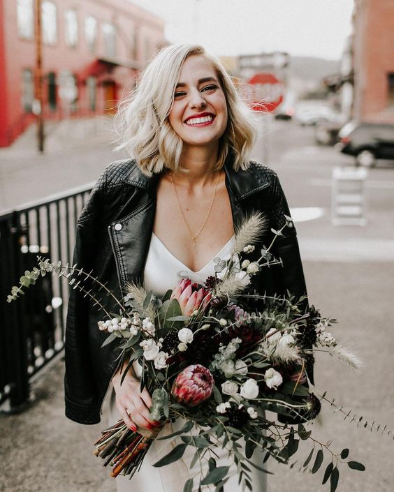 a black leather moto jacket is a bold and edgy idea to cover up for a fall wedding