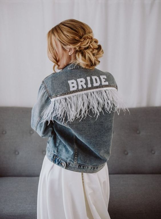 a blue denim jacket with long white fringe is a great idea for a slight boho touch to your look