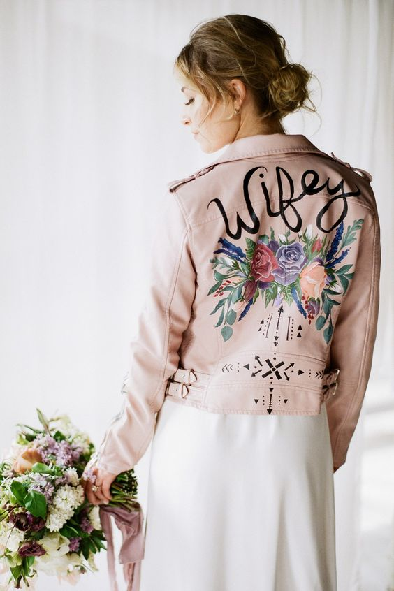 a blush leather jacket with handpainted flowers and patterns is a romantic touch to your look