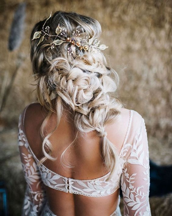 a catchy twisted and braided half updo with locks down and a beautiful embellished hair vine is amazing