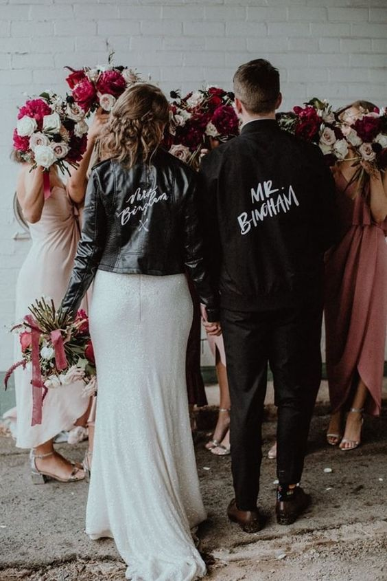 a customized black leather jacket will contrast your neutral wedding dress and make your look edgy