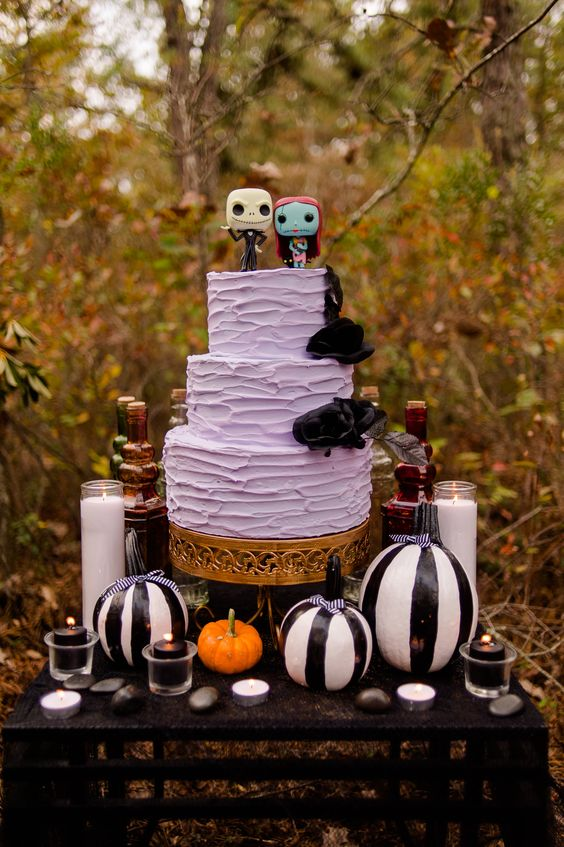 a lavender textural cake with black blooms and fun Sally and Jack Skellington toppers for a Halloween wedding