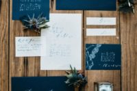a midnight blue and white wedding invitation suite with calligraphy and lace touches looks very elegant