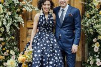a midnight blue star print wedding dress with thick straps and no sleeves looks very chic