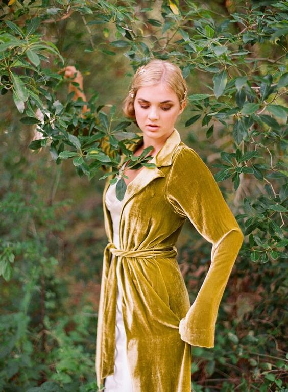 a mustard velvet robe is a unique idea for a bride to cover up, it looks chic and refined