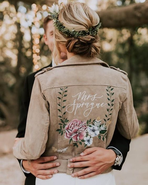 a neutral leather jacket with handpainted flowers and a new second name is a cool idea for the fall