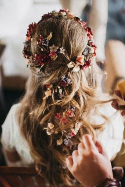 a relaxed boho half updo with some hair up and locks down, with bold fresh and dried blooms tucked in is a lovely idea for the fall