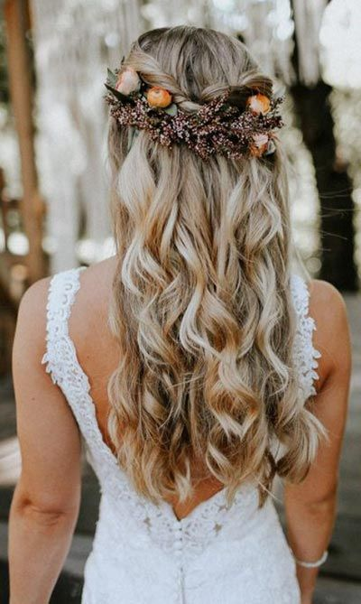 a wedding half updo with a braid and waves down, with bold blooms and blooming branches is a lovely idea for the fall