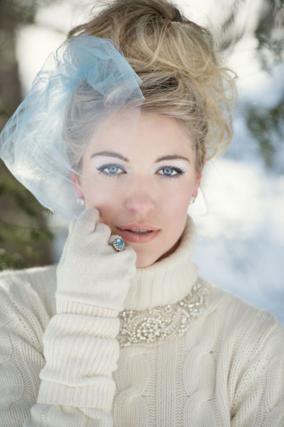a white cable knit sweater, matching handwarmers and gloves plus a ring over the gloves for a fashion statement