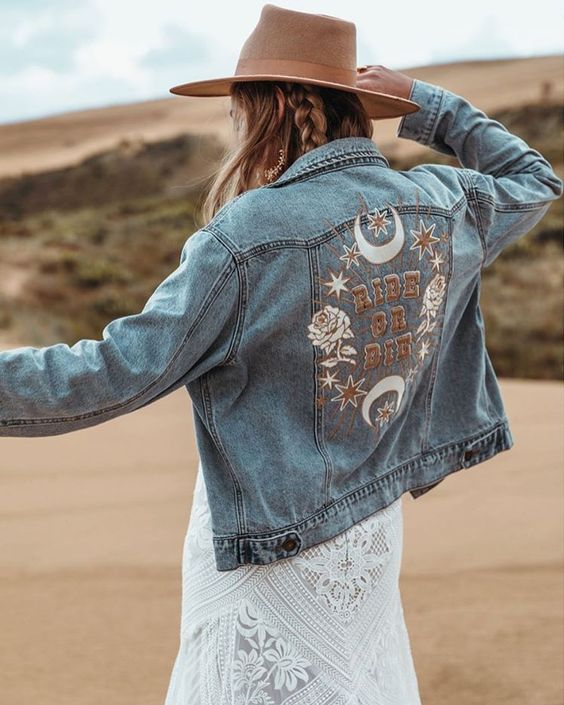 an embroidered and handpainted blue denim jacket and a camel hat will make your look more boho