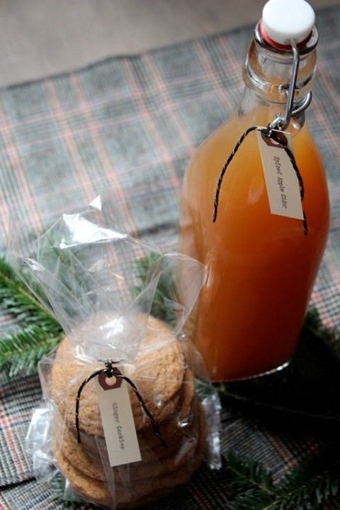 apple cider and cookies in a pack are a fantastic edible fall wedding favor, a whole meal in one
