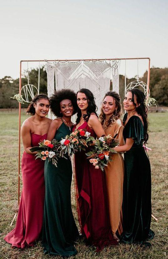 bold jewel-tone mismatching maxi bridesmaid dresses of plain fabric and velvet are amazing for a boho wedding
