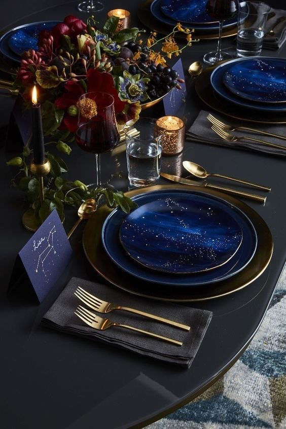 bright midnight blue sparkling plates and chargers and matching cards are perfect for a celestial wedding