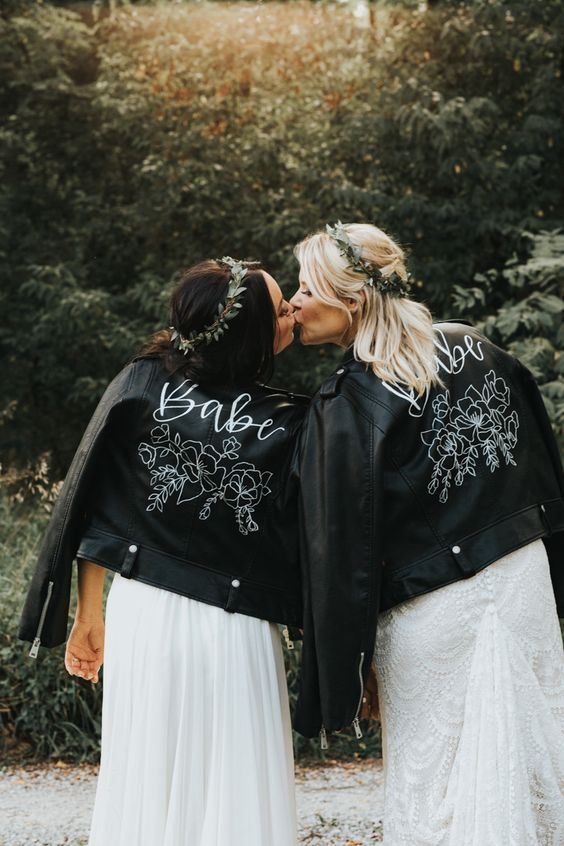 customized black leather jackets for both brides are a cool way to pull off a unifying touch