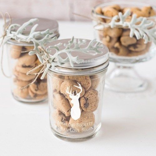 jars with chocolate chip cookies decorated with deer silhouettes and with pale greenery are fantastic for a fall or winter wedding