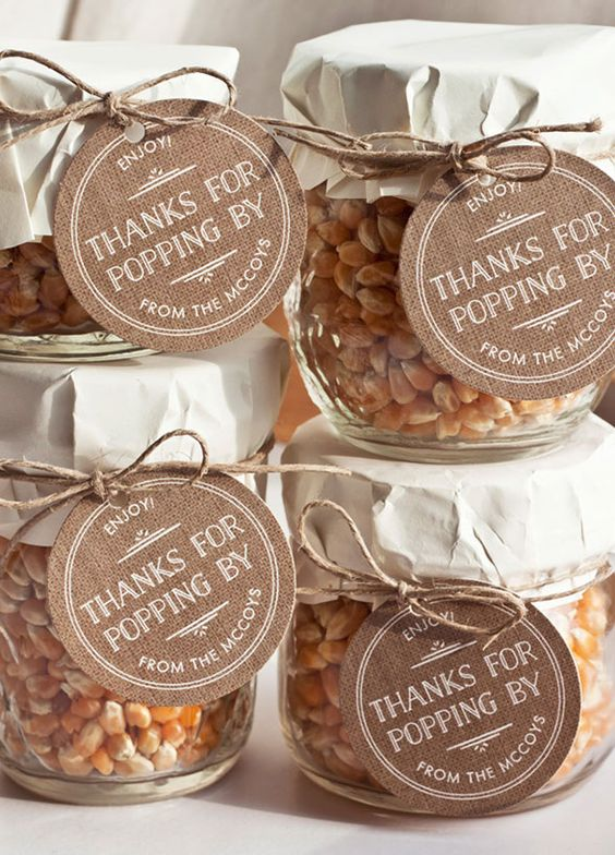 jars with corn, wrapped with paper and twine are great rustic fall wedding favors and can be easily DIYed