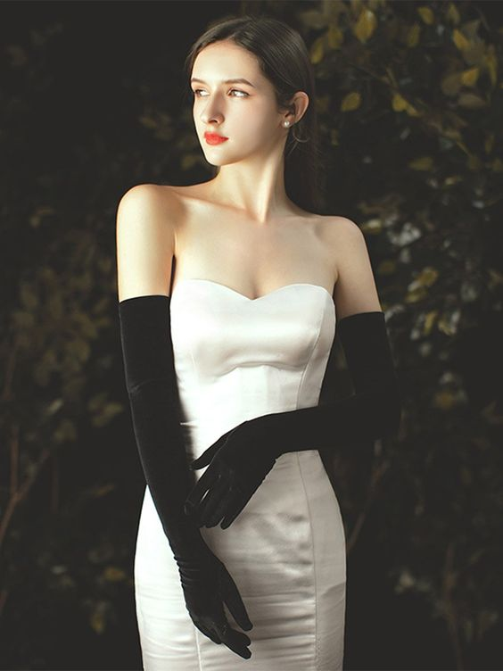 long black plain gloves like these ones will make a statement in any bridal look both with color and contrast