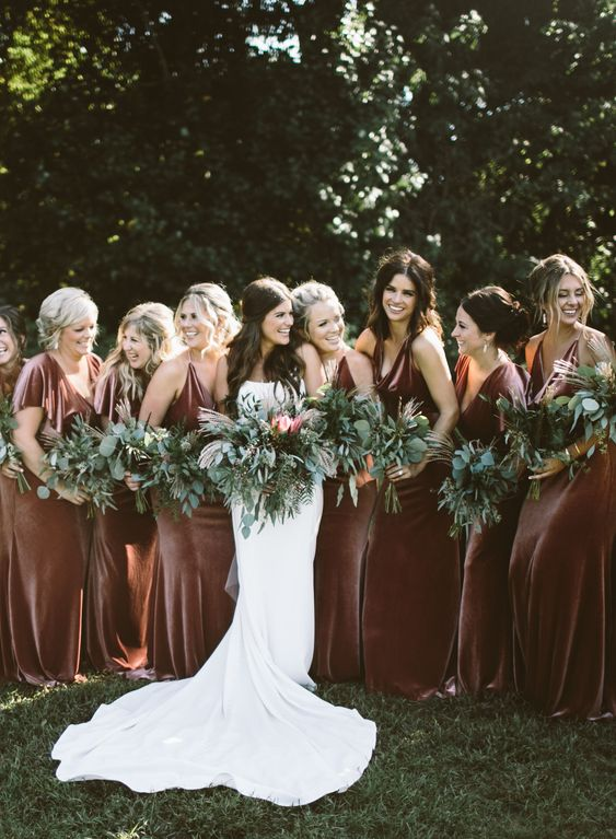 luxurious rust velvet maxi bridesmaid dresses with mismatching designs are very chic for a fall boho wedding