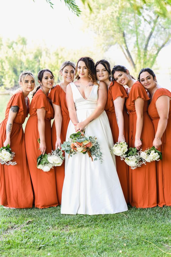 matching burnt orange maxi bridesmaid dresses with short ruffle sleeves are a pretty solution for a fall wedding in bright shades