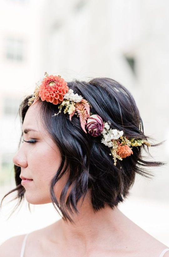 messy wavy short hair accented with a bold floral crown is a lovely idea for a fall bride or bridesmaid