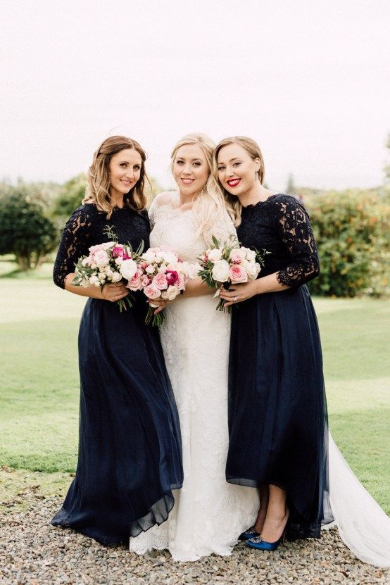 midnight blue high low bridesmaid dresses with lace bodices and long sleeves plus navy shoes