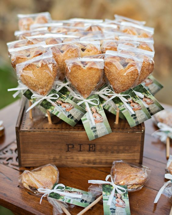 mini heart-shaped pies on sticks, with photos of the couple are amazing fall wedding favors, whether you make them yourself or not