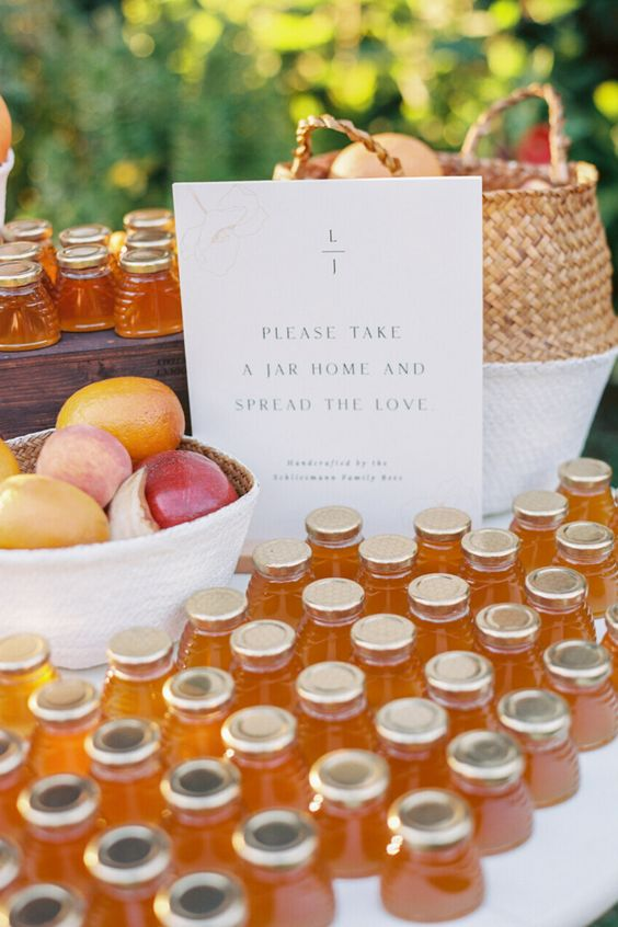 mini honey jars and fresh fruit are perfect fall wedding favors, those who don't like sweets, will choose fruits