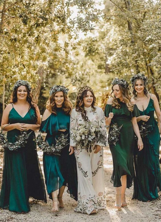 mismatching emerald and teal bridesmaid dresses with various necklines and silhouettes are very chic and cool