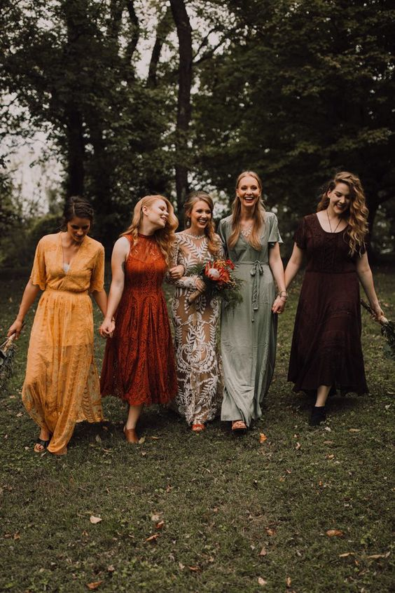 mismatching lace and plain bridesmaid dresses in yellow, rust, deep purple and sage green are adorable for a fall boho wedding