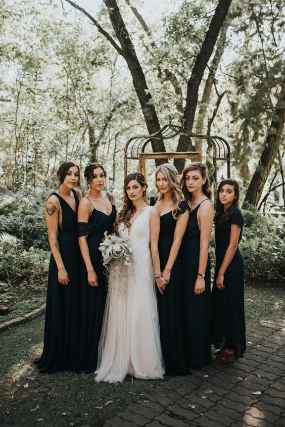 mismatching midnight blue maxi bridesmaid dresses are a gorgeous idea for a dark and moody fall wedding