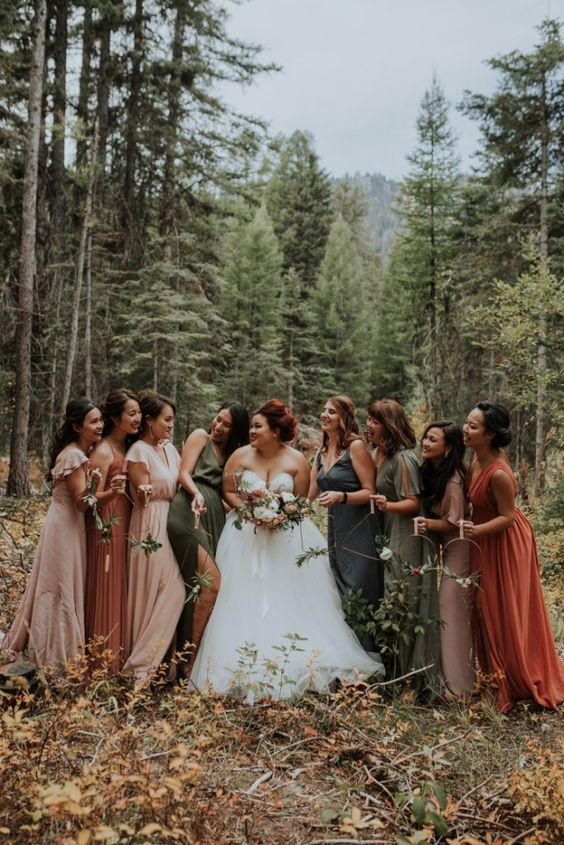 mismatching muted tone maxi bridesmaid dresses in blue,olive green, dusty pink and rust are a great idea for the fall