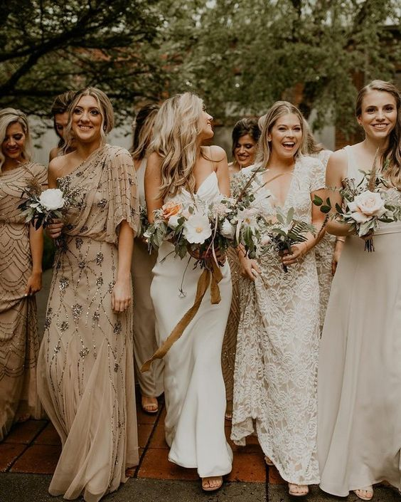 mismatching nude and white bridesmaid maxi dresses are adorable for an early fall wedding with a neutral color scheme