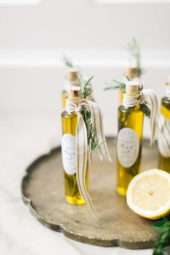 olive oil in small and tall bottles, with ribbons and herbs attached is a great idea for any kind of wedding, from a fall to a summer one