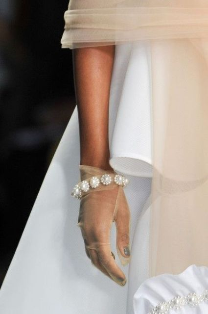 sheer tan gloves with heavy embellishments will make your look more refined and bold
